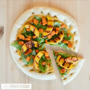 vegan cauliflower pizza with hummus and grilled peach