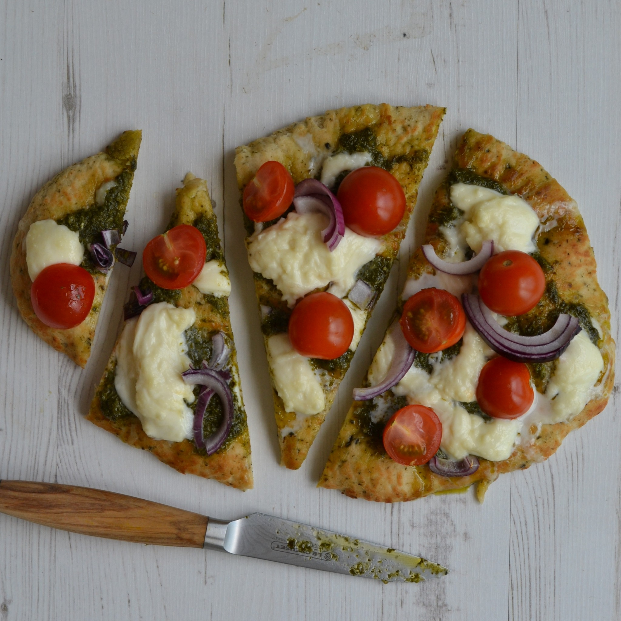 naan pizza mozzarella pesto tomatoes